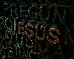 black and brown Jesus embossed sign