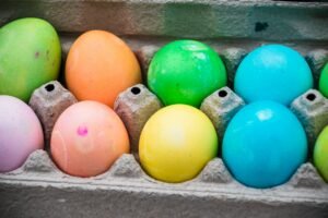 yellow blue and pink egg on tray