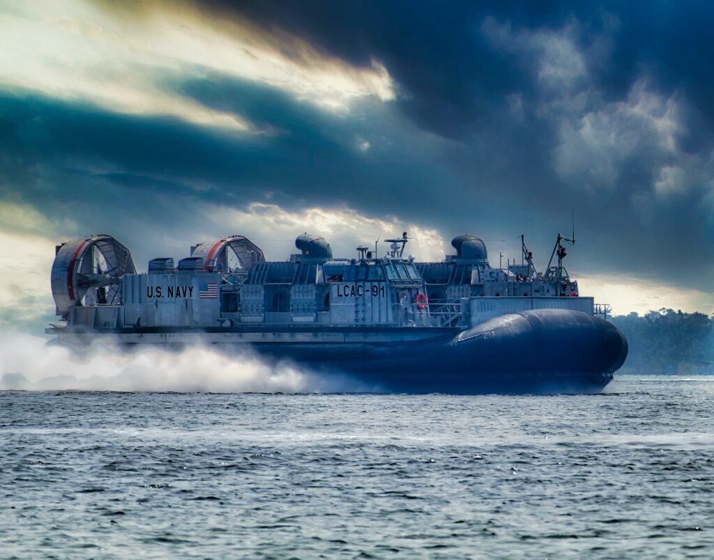 blue and white ship on sea under cloudy sky during daytime