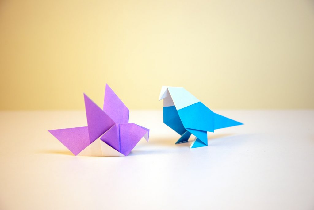 two purple and blue papers